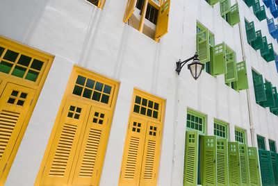 colorful rows of windows in a white wall.