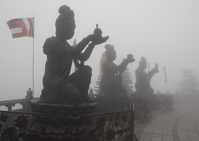 three smaller statues surrounding the Tian Tan Buddha on Lantau Island, Hong Kong, China