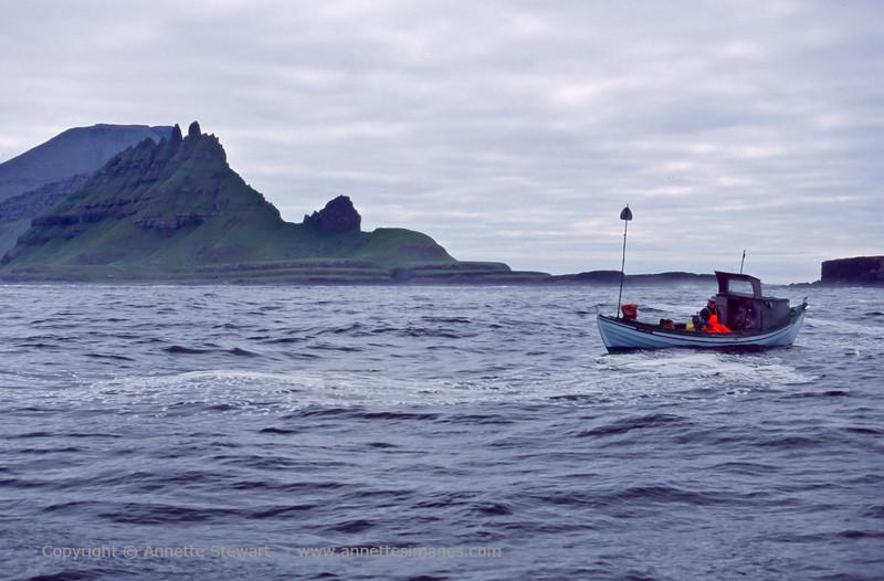 Fisherman near Tindholmur island