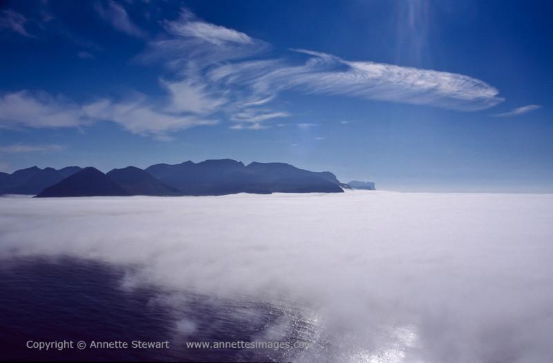 Kalsoy view across sea-fog to Eysturoy