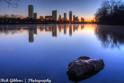 The sun about to make an appearance over the Austin skyline and Lady Bird Lake