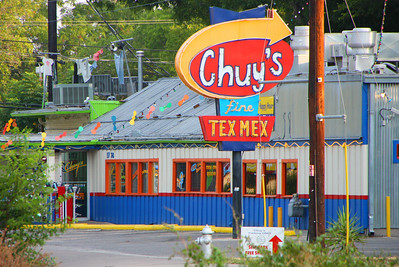 Chuy's Tex Mex restaurant serves great food and a fine Elvis shrine.  There are several in town.  This one is on Barton Springs Rd, near downtown.  Be sure to ask your server for some of their secret creamy jalapeno salsa when you are there.