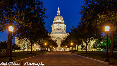 The Texas State Capitol building and complex are locted in downtown Austin, sited on one of the highest points in Austin.  It was completed in 1888, built from red granite quaried just 50 miles from Austin