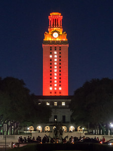 The University of Texas Clock Tower is an iconic symbol of UT Austin.  It is usually illuminated at night with white lights, but on noteworthy athletic victories it will be illuminated orange with a white #1.