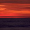 The distinct colors and seperation of the ocean and sky give an abstract perspective of the sunset.
