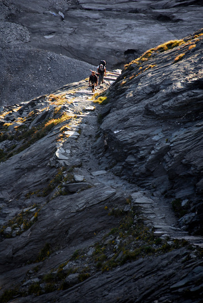 Hikers on trail near Franz Joseph Glacier, Austria