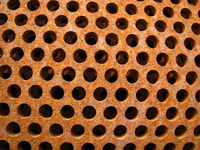 Holy!  Nested cylinders of iron with holes. I have no idea what this was for, but it's a great photo subject.