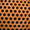 Holy!<br /> <br /> Nested cylinders of iron with holes. I have no idea what this was for, but it's a great photo subject.
