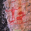 """North Hegman Pictographs.  The arrangement of figures at the main panel of the North Hegman Lake, Minnesota rock art site appears to have been carefully composed at one time by one rock artist. Its present excellent condition suggests either that it may not be especially old or that it is a site where an older pictograph has been repainted. The rock art appears to represent Ojibwe meridian constellations visible in winter during the early evening, knowledge of which may have been useful for navigating in the deep woods during the winter hunting season. Support for a suggested multi-layered interpretive model comes from a review of various culturally specific ethnohistorical sources. The inclusion of elements from widely known Ojibwe legends and references to constellations with cosmological or religious significance make it an intriguing scene with many interesting culturally specific referents. This panel is perhaps the most visited and photogenic pictograph within the State of Minnesota and it possesses remarkable artistic merit. <br /> <br /> <br /> Some of the best known and most photographed pictographs in the Upper Midwest are located at North Hegman Lake, northwest of Ely, MN, in the Boundary Waters Canoe Area Wilderness on a granite cliff overlooking the water. This rock art is located within the """"northern woodlands"""" stylistic rock art region of Campbell Grant (1983) and Klaus Wellmann (1979).<br /> <br /> The panel shows a human figure in an outstretched arms posture standing near a quadruped animal with a long tail, possibly a dog or wolf, and a remarkably well drawn bull moose with splayed hooves and dew claws. (A dew claw on a moose is a reduced hind toe or the false rudimentary hoof above the true hoof .) Beneath these figures is a long horizontal line, probably representing the ground or horizon, and above the human figure are two vertical rows of short horizontal lines or dashes. One set has 4 lines and next to it are 3 lines. Above and to the right a"""