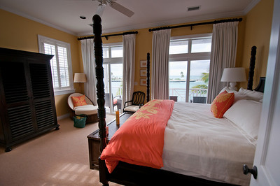 Main bedroom along with balcony and view of marina harbor.