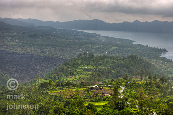 Lake Batur, below the eastern flank of Mt. Batur, one of Indonesia's more active volcanoes - last eruptions were in 1999-2000.