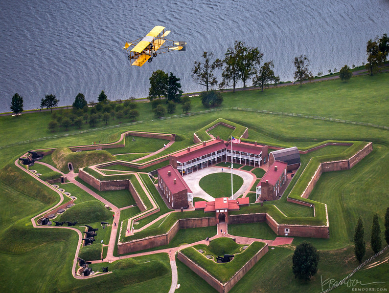 A 1912 Curtiss Pusher flies over Fort McHenry