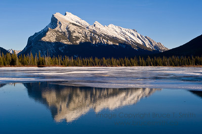 Rundle Mountain reflection on a mild winter day