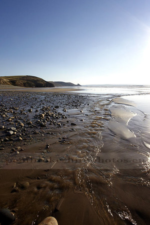Breaking the rules, shooting straight into the sun!<br /> Winter Walk at Newgale