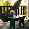 we all came down with intestinal troubles our last few days in belize ... leif was super sweet-natured about it all, snoozing in the hammock strung on the porch of the manatee lodge. his journal and a bottle of water are next to him as he dozes with a cold cloth on his fevered face.