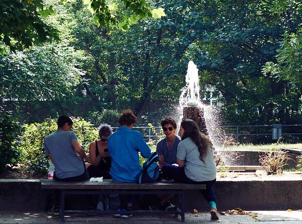 People near a fountain in Berlin