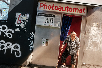 A woman getting out of a photo automat in Berlin