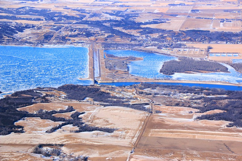 Gavins Point Dam, Lewis and Clark Reservoir on the left, Missouri River on the right.  Nebraska in the foreground, South Dakota across the river.  The tail waters below the dam was one of our favorite family fishing spots growing up.
