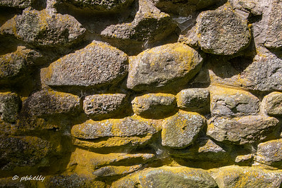 Patterns in the stone foundation of the hut.