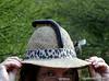Mom tries on the latest fashion.<br /> Gaborone bird watchers trip, Botswana.