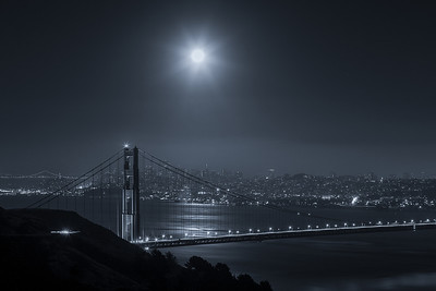 Full Moon Star Over San Francisco  Another shot I got the other night during the Full Moon. This is more like a Moon Star! July 3, 2012  Canon 5D MK III Canon 70-200mm f/4 L Induro Tripod