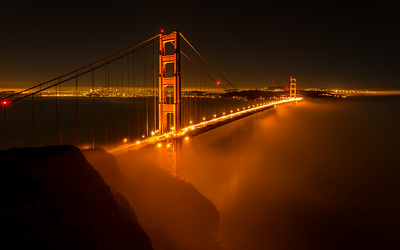 Low Fog I was having dinner in Sausalito tonight, and on the way back I stopped to show my rents the my favorite view with low fog. I stupidly left my camera at my place. Luckily I moved to Baker Beach so I went across the bridge to grab my gear and raced back. The fog started to thin out but was still able to get a few foggy shots. — at Golden Gate Bridge.