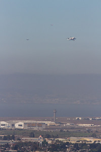 Space shuttle Endeavour flyover passing the Oakland airport.
