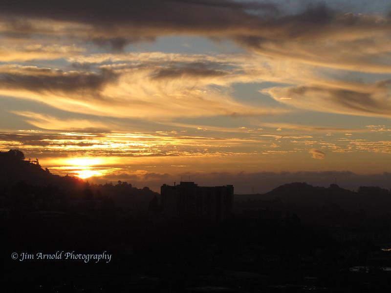 Swirly-Cloud Sunrise - Larkspur