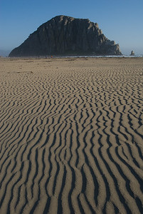 Sand pattern with Morro Rock in background.