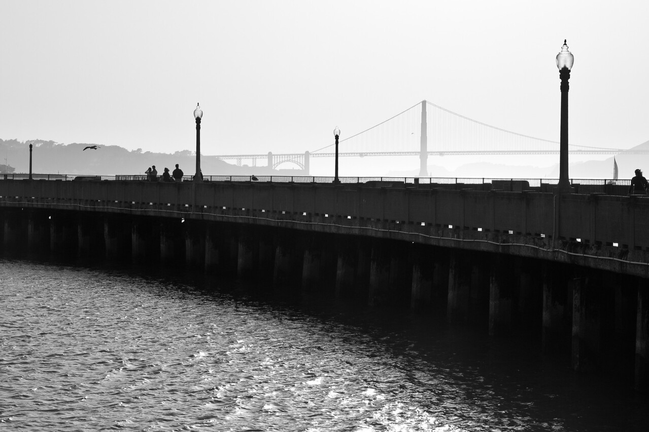 Municipal Pier and Golden Gate Bridge in late afternoon.