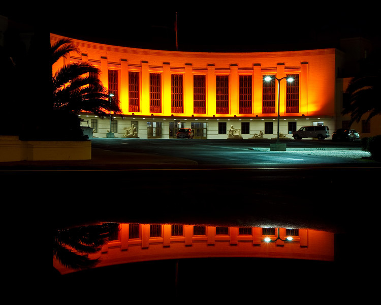 Building in orange and reflection on Treasure Island The orange is in support of the San Francisco Giants, currently playing in the World Series.