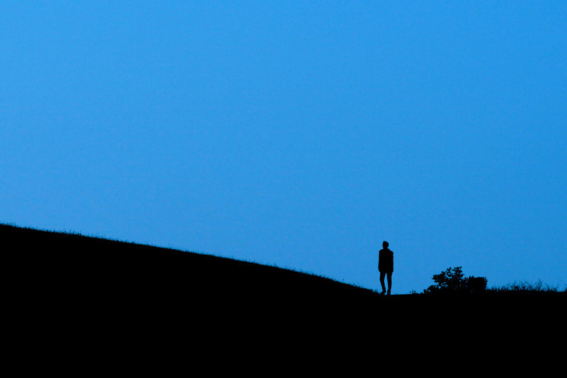 Twilight walker (with dog) at Fairmont Ridge above Castro Valley, CA.
