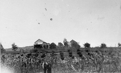 William and Caroline Fauth in front of their home  sometime before 1898.  William was a cabinet maker but also worked in gold mines.  southwest corner of Camino Del Norte and Flores De Oro.  Photographer is facing east.