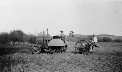 Seeding grain field in 1930.  Bruno Denk on tractor, Edward Cole on seed drill.  Location 300 yards southeast from Rancho Santa Fe road and Encinitas Blvd.