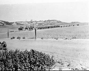 Military marching on road during WW1.  Horses and solders on Rancho Santa Fe road.  Photo taken near termination of Jennifer Lane looking west with woodwind rd, in about center.
