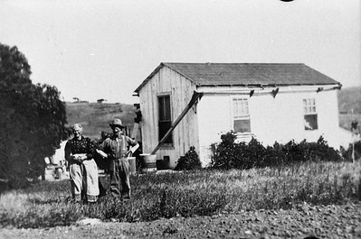 Mrs and Mr. Peter Shelvett in front of their house in about 1915.  Pet was a Frenchman and homesteaded here sometime before 1884.  Their homestead was 320 acres and included what is today Wildflower and Country Rose estates.   The house was located 200 feet north of Fortuna Ranch road and Bumann road.  Photographer is facing east.