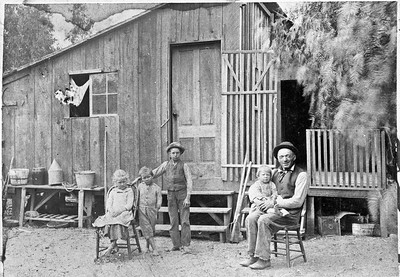 Conrad Gut holding Bill Teten while Margaret Teten, John Teten and Walter Hauck stand by.  Photo taken about 1896.  Location is 100 yards east from termination of 5th street.
