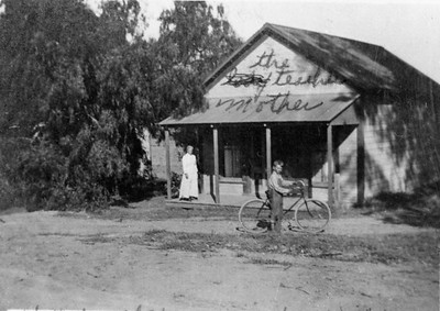 The Hess store in about 1918 or 1919.  Arthur D. Cole on bicycle and Mrs. Colburn on porch.  Located at 441 Rancho Santa Fe road.