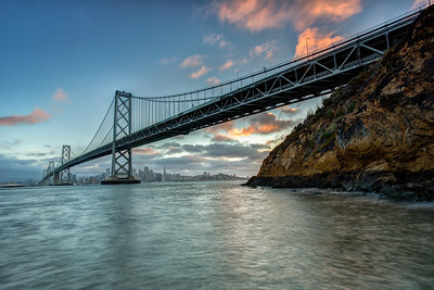 The Beautiful Bay Bridge Skyline at Sunset  This location sure was awesome. Going to have to venture back here for more sunset's and even some night shots.  Canon 5D MK III Canon 17-40mm f/4 L Lee Foundation Kit Lee .9 Soft Grad ND Filter 3 Exposures Fusion Blended  ISO 100 f/22 0.5, 2.0 and 4.0 Seconds
