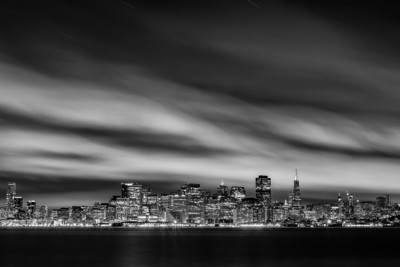 The San Francisco Skyline  Last night I organized a photowalk on Treasure Island with a bunch of people I have met through G+, other photowalks and some new people! A group of us got there early to do some abandoned building exploring, then met up with the rest of the group to head over to the Bay Bridge area for sunset. I was amazed with how many great people showed up. After the Bay Bridge we all met back at Bliss, which was not lit up :( Thanks Doug for lighting it though! The clouds over the city were a blessing though. Here is one shot I got from the end of the walk.  Canon 5D MK III 70-200mm f/4 L ISO 100 f/18 408 Seconds Processed in Silver Efex Pro 2