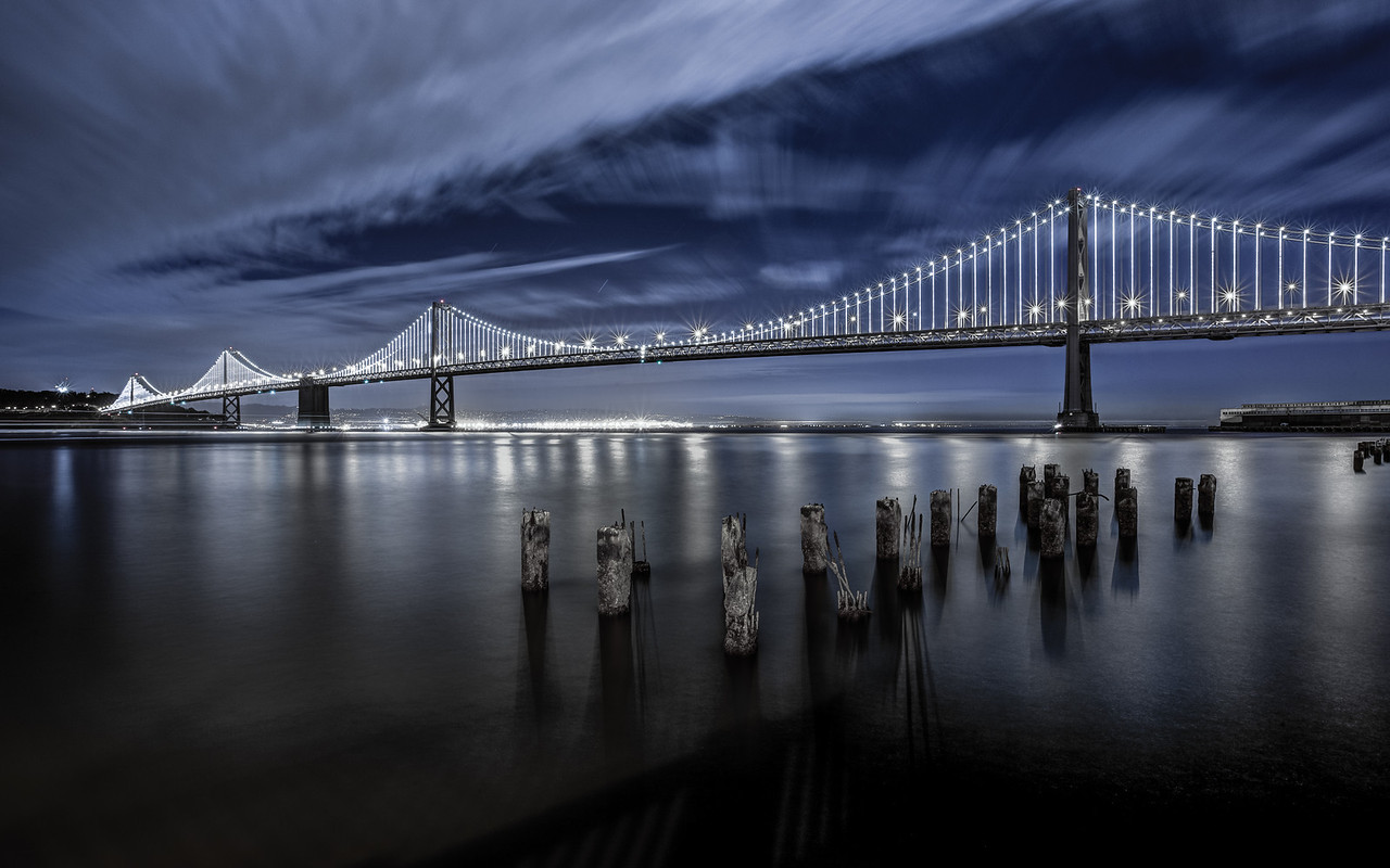 **The Bay Lights** It looks like a whole new bridge! On Friday night I found out they would be testing the new lights, so why wouldn't I go shoot it. The lights dance however, but it's not the easiest shot to get, unless you shoot at a crazy high ISO to capture the light patterns. Either way, the lights look awesome.   Starting March 5th (Grand Lighting) they will be for a couple years, or even longer if people petition to keep them up like the last set of lights!  The Bay Lights is an iconic light sculpture designed by internationally renowned artist Leo Villareal. This stunning fine arts experience will live for two years on the San Francisco Bay Bridge West Span, starting with the Grand Lighting on March 5, 2013. Visit www.thebaylights.org/ for more information on the project. It will also become world's largest light sculpture. — at Bay Bridge.  Website   facebook   Google+   Blog   Stipple
