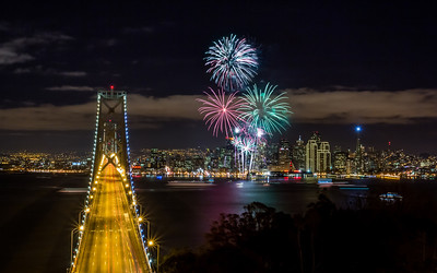 San Francisco 2013 New Years Fireworks As usual I am always racing to the spot. We didn't leave my place till 11pm. Getting through the city was easy and no cars at all, then all of a sudden half way across the Bay Bridge we hit the stop traffic trying to get into Treasure Island. I thought we wouldn't make it. After about 20 minutes we finally got to the turn up Yerba Buena Island and drove to the top parking lot, which had zero cars. It was odd Being the only car up there, I thought we were going to have to double park. So we ran down the hill, walked through the large group of people that were standing behind the fence and we hopped over it. No one was in front yet until they saw us do it. All I wanted was the center line up of the towers. Well I would have liked a better angle with the bridge, but there is always next year. Happy New Year everyone!   Prints on my +SmugMug: http://smu.gs/Uj7gC3