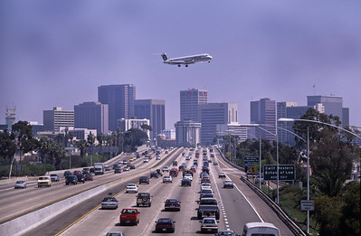 Plane on approach to airport.  Photo taken from overpass above highway 5, San Diego, California.