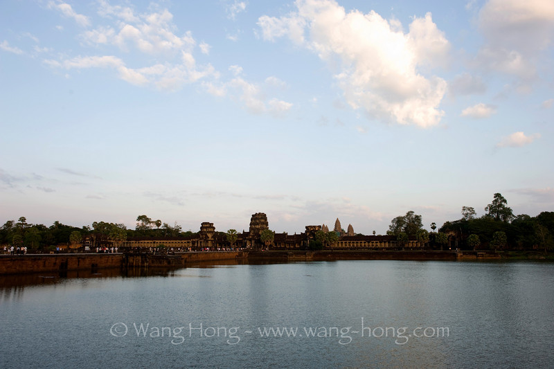 Angkor Wat - moat, wall and towers late afternoon