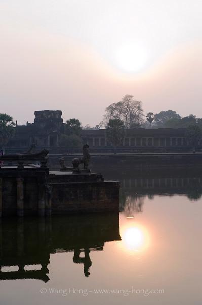 By the moat at Angkor Wat.