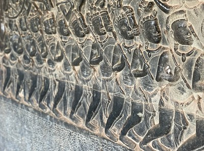 Part of a story engraved on the walls at Angkor