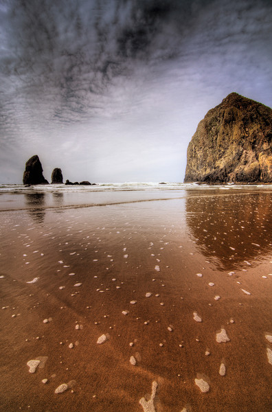 Cannon Beach, OregonBy: James A. B.  My girlfriend and I spent a weekend there, just touring around seeing the sights. It was of course mostly rainy while we were there, but that didn't dampen our fun.. eh eh get it… dampen! so hilarious I know. I think the next time we go will be in July so perhaps we'll have better luck then in getting at least a cool sky pic!  - Read More on my Photo Blog: Raining Dreams- Or if you're Facebook Happy: My Facebook Page- Or if you're Google Savvy: My Google+ Page