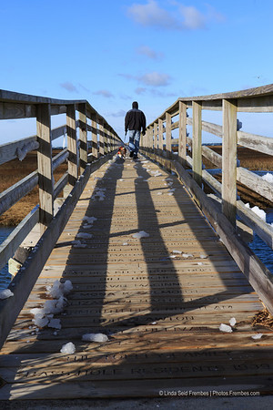 My husband and dog on the boardwalk at Gray's Beach in Yarmouth, MA. - December 2012