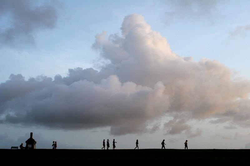 Tourists stroll toward El Morro fort in San Juan, Puerto Rico.