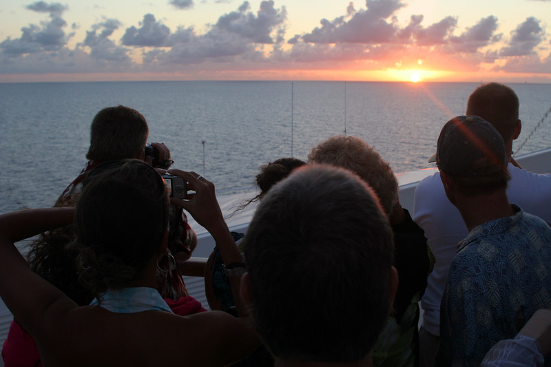 Passengers watching the sunset